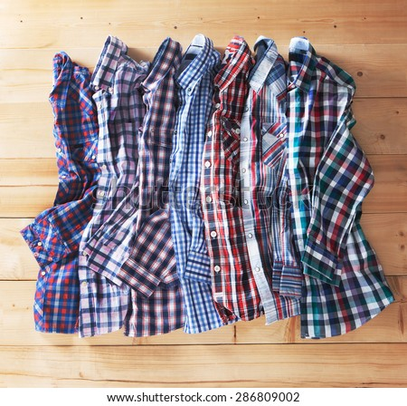 shirts plaid in plan with wooden background