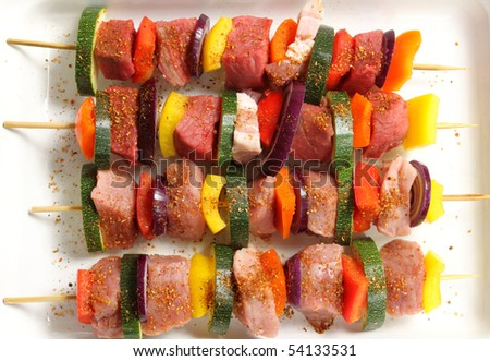 Shish kebab - delicious meat cuisine with  zucchini, onions and peppers. - stock photo
