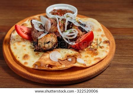 Shish kebab on bread. Tasty and healthy food, European cuisine. - stock photo