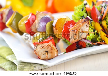 Shish kebab with pork, potatoes, vegetables and salad - stock photo