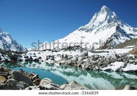 Shivling peak and beautiful lake in Himalayan - stock photo