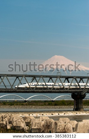 Shizuoka - April 13,2015: Shinkansen bullet train and Mountain Fuji on April 13, 2015 Shizuoka ,Japan. Shinkansen is world's busiest high-speed railway operated by four Japan Railways companies