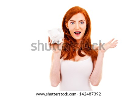 Shock woman with piggy bank in her hand over white background