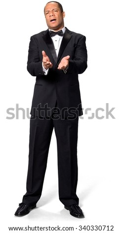 Shocked African man with short black hair in evening outfit pointing using palm - Isolated