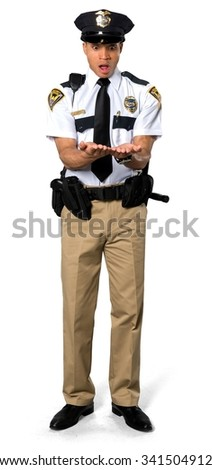 Shocked African young man with short black hair in uniform holding invisible object - Isolated