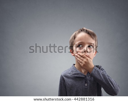 Shocked and surprised boy looking into copy space concept for amazement, astonishment, making a mistake, stunned and speechless or back to school - stock photo