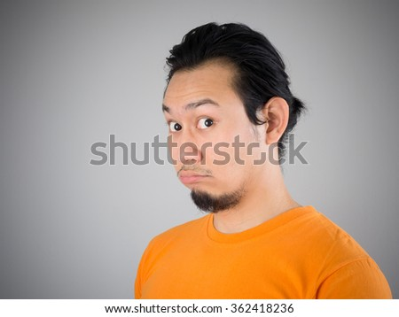 Shocked and surprised face of Asian man wonder. - stock photo