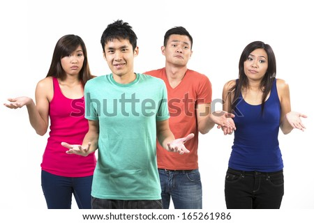 Shocked and surprised group of Chinese friends. Isolated on a white background.