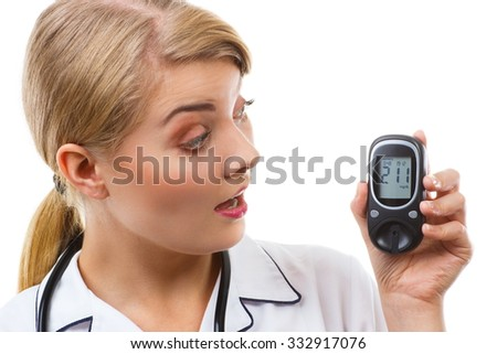 Shocked and worry woman looking at glucose meter with bad result of measurement sugar level, concept of diabetes, checking sugar level, white background