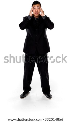 Shocked Asian man with short black hair in business formal outfit with clasped hands - Isolated - stock photo