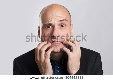 shocked bald man isolated on a gray background - stock photo