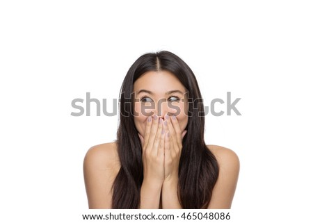 shocked beauty shot of Chinese woman shot in the studio with her hands covering her mouth