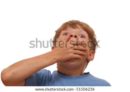 Shocked boy covers his mouth with his hand - stock photo