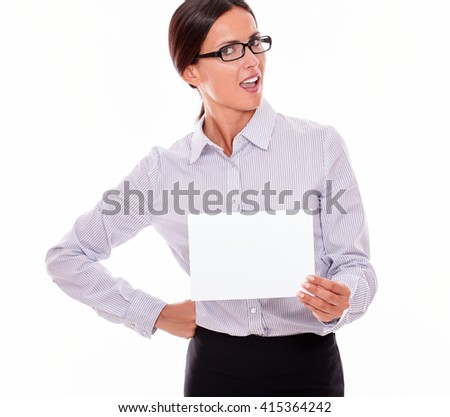 Shocked brunette businesswoman with glasses, wearing her long hair tied back, and a button down shirt, holding a blank signboard in one hand, the other hand on her hip
