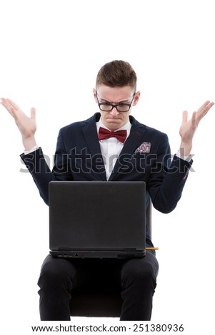 Shocked businessman working on a laptop - stock photo