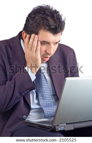 Shocked businessman working on a laptop against white background