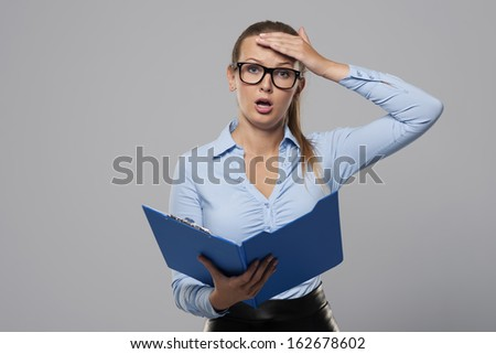Shocked businesswoman make a mistake in office documents  - stock photo