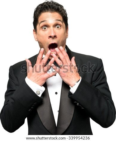 Shocked Caucasian man with short black hair in a tuxedo talking with hands - Isolated