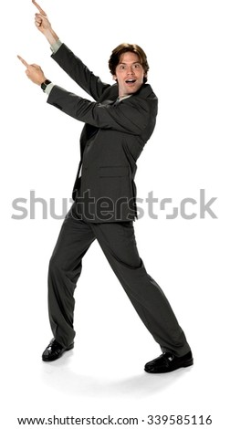 Shocked Caucasian man with short dark brown hair in business formal outfit pointing using finger - Isolated