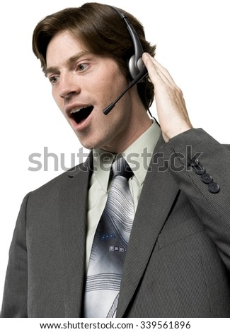 Shocked Caucasian man with short dark brown hair in business formal outfit talking on headset - Isolated