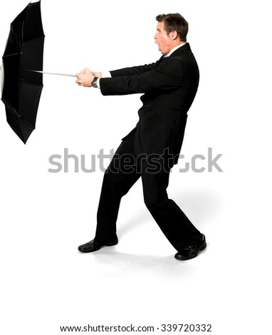 Shocked Caucasian man with short medium blond hair in business formal outfit holding umbrella - Isolated - stock photo