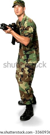 Shocked Caucasian Soldier In Green Camouflage Uniform aiming with rifle - Isolated