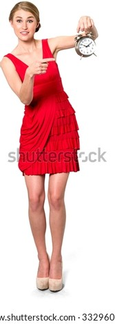 Shocked Caucasian young woman with medium blond hair in evening outfit holding alarm clock - Isolated - stock photo