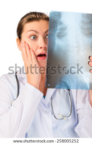 Shocked doctor with x-ray ill patient - stock photo