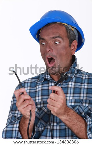 Shocked electrician - stock photo