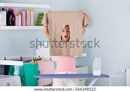 naked woman ironing board