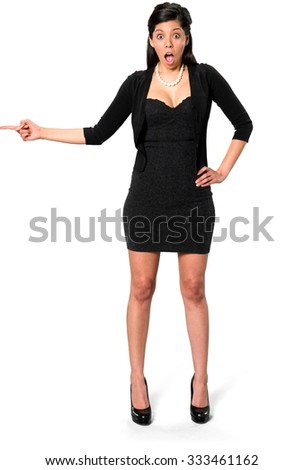 Shocked Hispanic young woman with long dark brown hair in casual outfit with hands on hips - Isolated