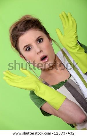 Shocked houseworker - stock photo