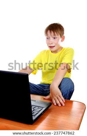 Shocked Kid with Laptop Isolated on the White Background - stock photo