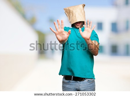 shocked man with a paper bag in his head - stock photo