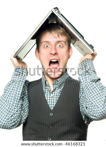Shocked man with laptop over his head over white - stock photo