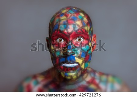 Shocked Superhero portrait, colorful face art with tilt shift and motion blur effect. - stock photo