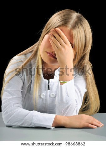 Shocked woman closing face with hands, on black. - stock photo
