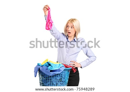 Shocked woman found someone else's panties while laundering isolated on white background - stock photo