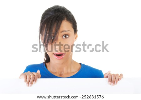 Shocked woman holding blank banner. - stock photo