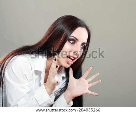 Shocked woman looking at something - stock photo