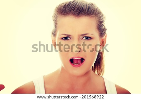 Shocked woman portrait with opened mouth
