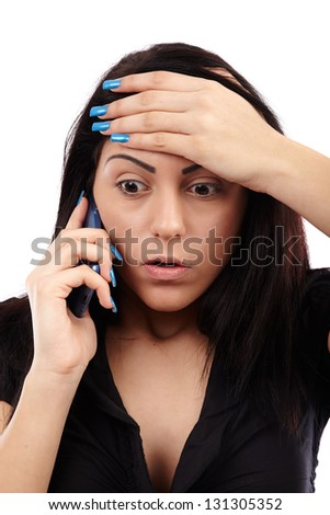 Shocked woman talking on the phone, closeup pose, isolated over white background