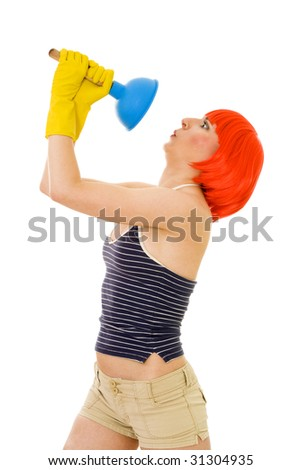 Shocked woman with cleaning tool standing with red hair