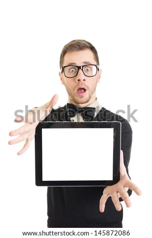 Shocked young nerd man showing blank tablet screen - stock photo