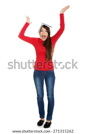 Shocked young student woman with notebook on head. - stock photo