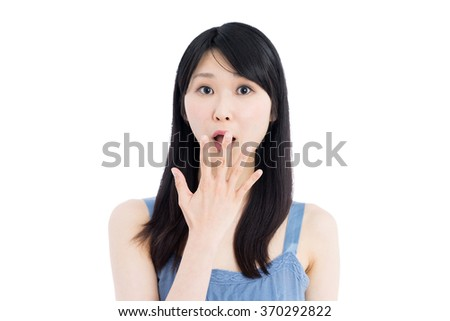shocked young woman isolated on white background - stock photo