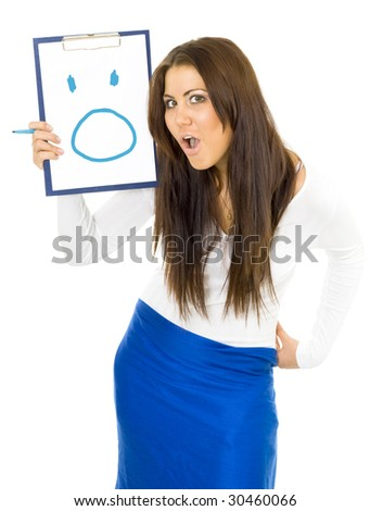 Shocked young woman standing expressing emotion and drawing smile on pad with blue pen - stock photo