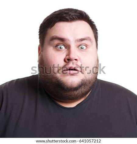 Shocking news. Surprised fat man expressing amaze on face, standing on white isolated background, studio shot