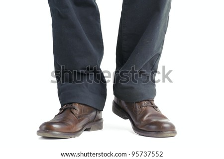 shoe and leg of a businessman caution step