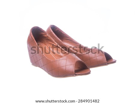shoe. Brown colour fashion woman shoes on a background